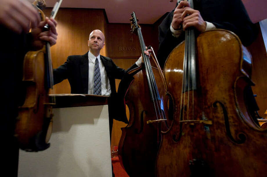 Mark Shapiro, a double bassist with the Houston Symphony talks with colleagues before Brown Bags and Baroque, a free lunch show by the Houston Symphony on Tuesday. Photo: Nick De La Torre, CHRONICLE