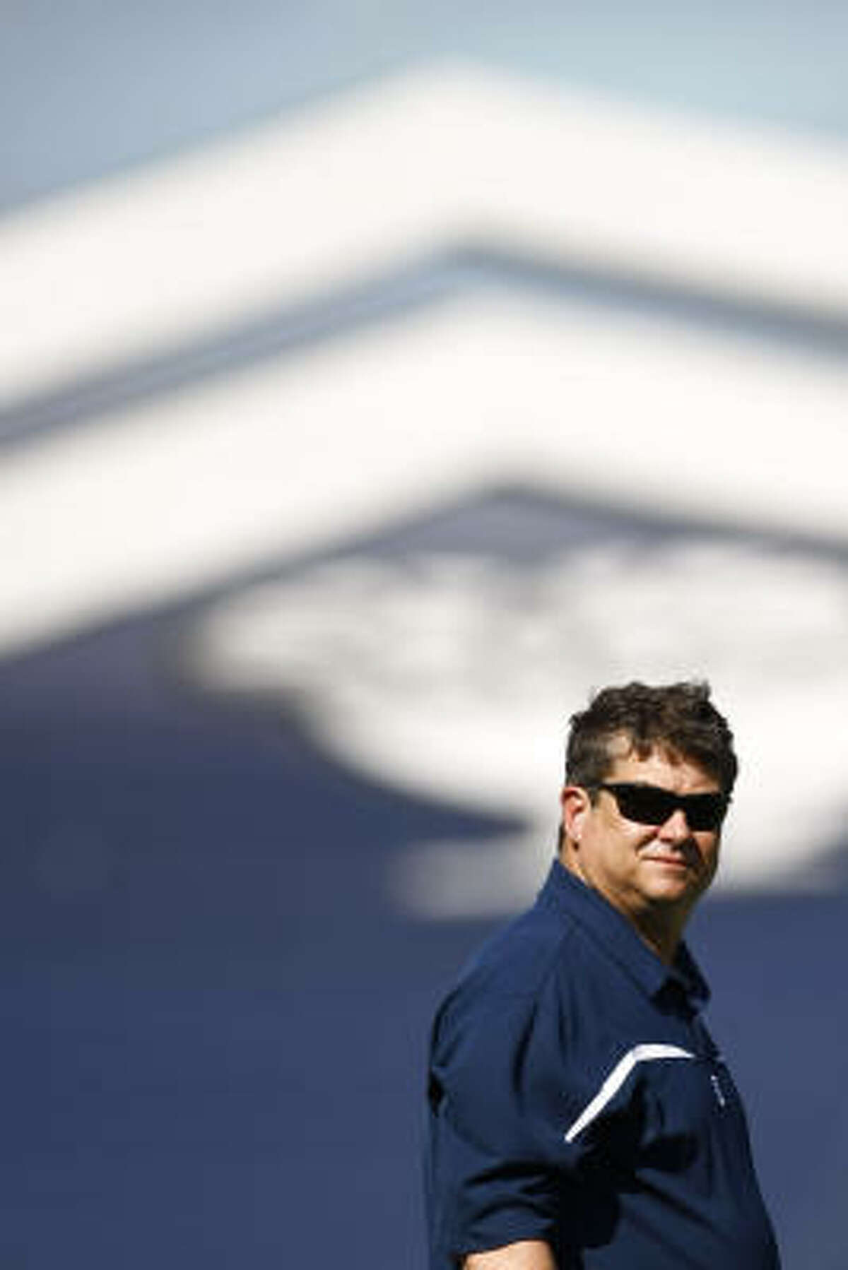 Head Coach David Bailiff watches warm-up drills during Rice's first spring football workout.