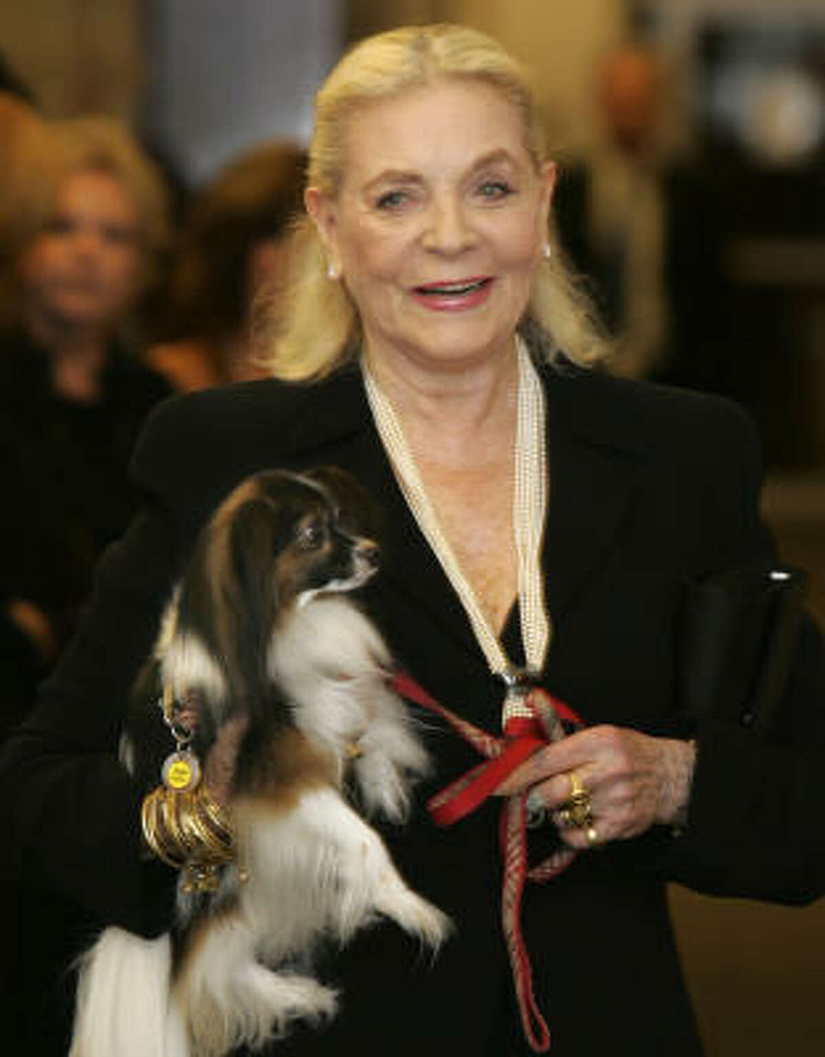 Lauren Bacall carries her dog