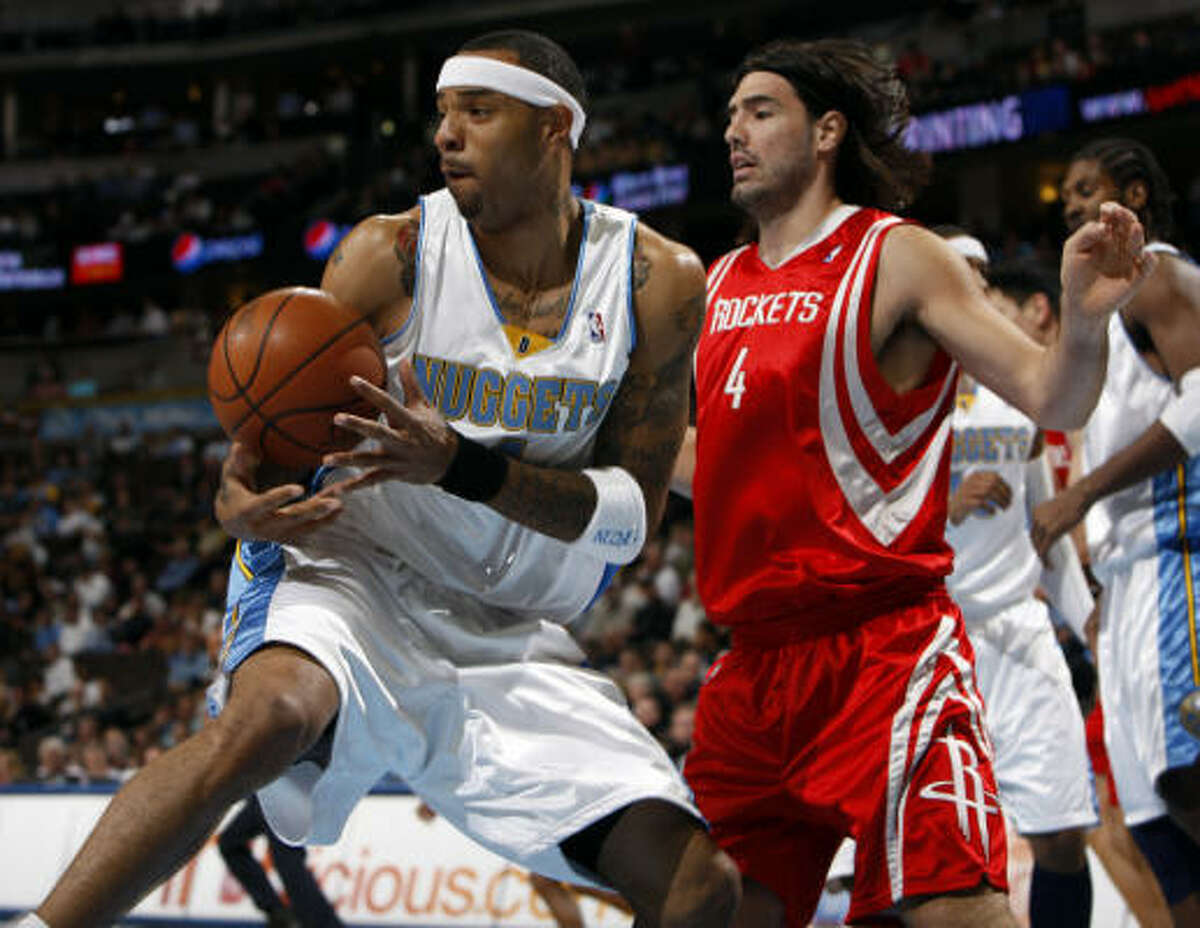 Nuggets forward Kenyon Martin, left, pulls down a rebound in front of Rockets forward Luis Scola in the first quarter.