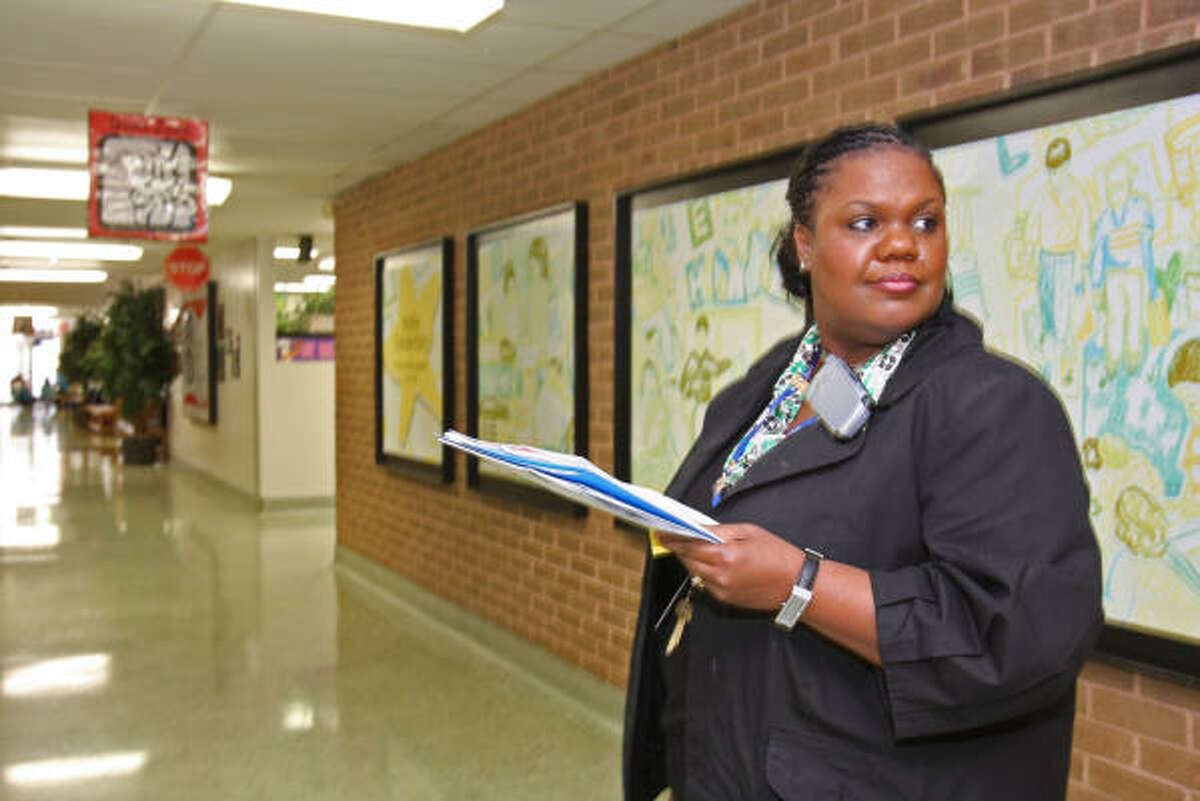 Wolfe Elementary School at 502 Addicks-Howell Road is forty years old this year, being built in 1969. It is hoped that Katy ISD will consider renovating the facility to bring the school up-to-date. Assistant Principal Lisa Forney watches students change classes in one of three hallways.