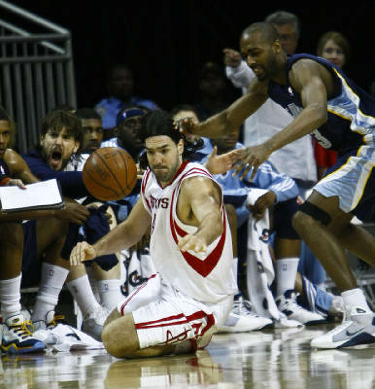 Luis Scola (4) goes for the steal against Grizzlies forward Quinton Ross. Scola scored 18 points and had 14 rebounds in 29 minutes.