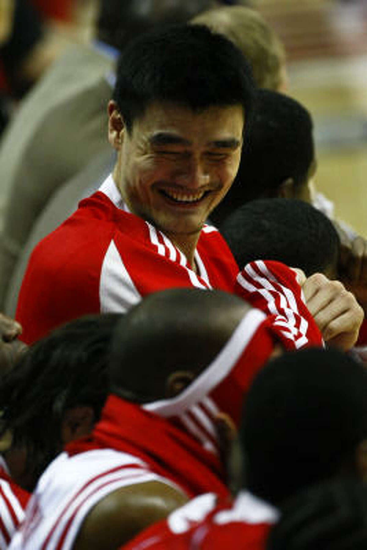 Rockets center Yao Ming jokes with teammates. Yao scored a game-high 24 points to go along with 17 rebounds against the Grizzlies.