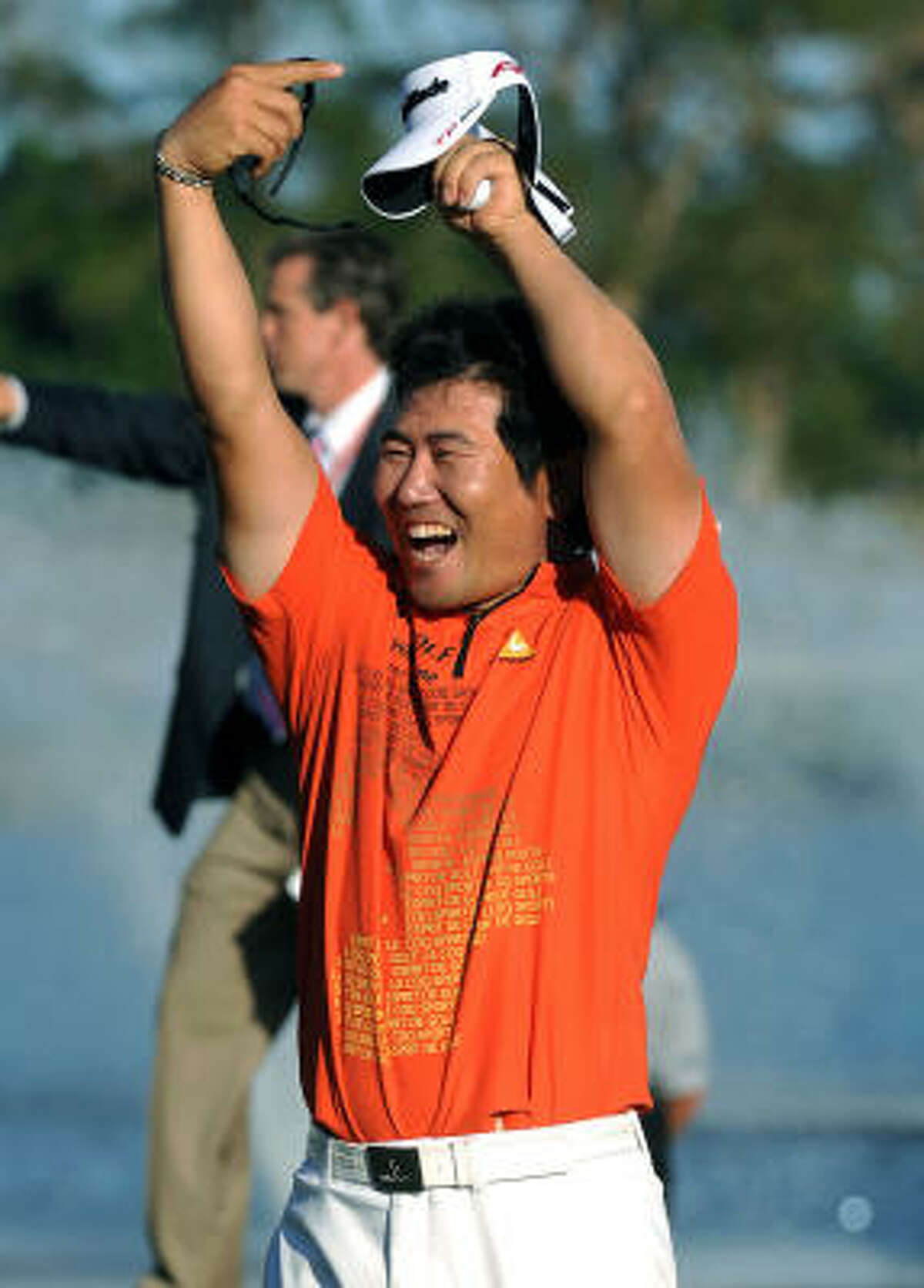 Y.E. Yang celebrates after making par on the final hole to win the Honda Classic by one shot.