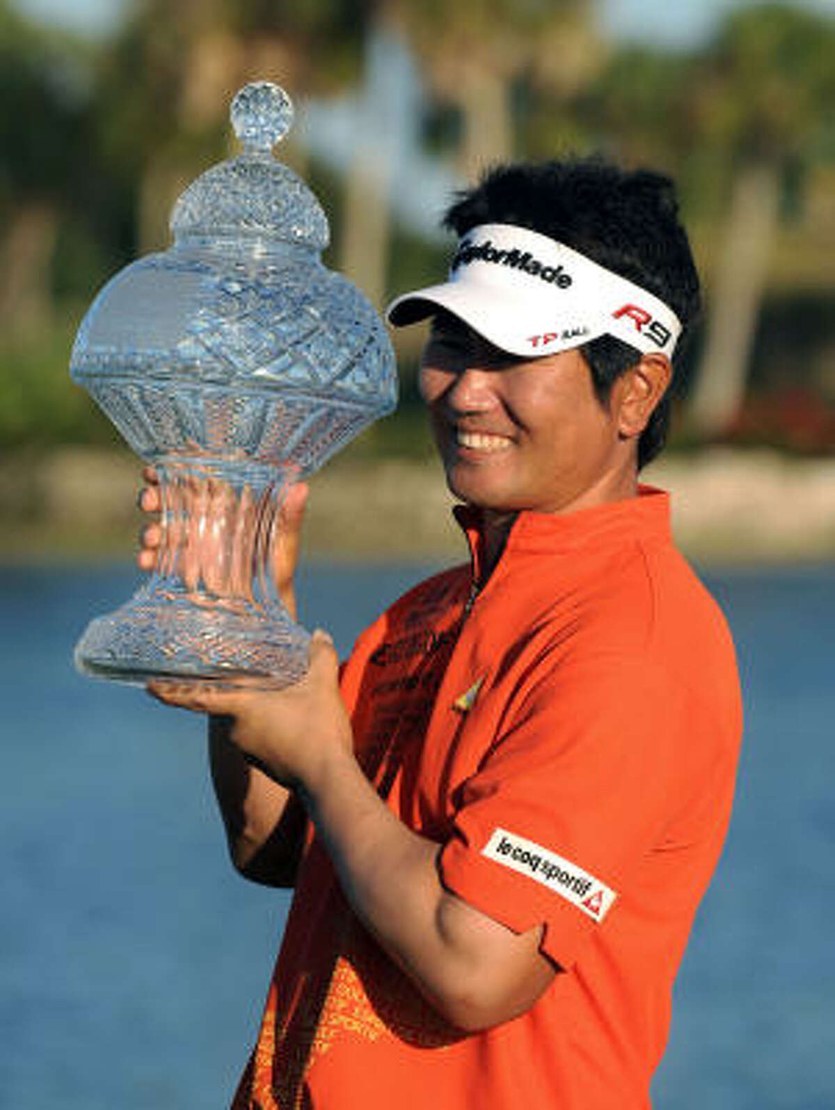 Y.E. Yang holds his trophy after winning the Honda Classic by one shot at the PGA National Resort and Spa in Palm Beach Gardens, Fla.