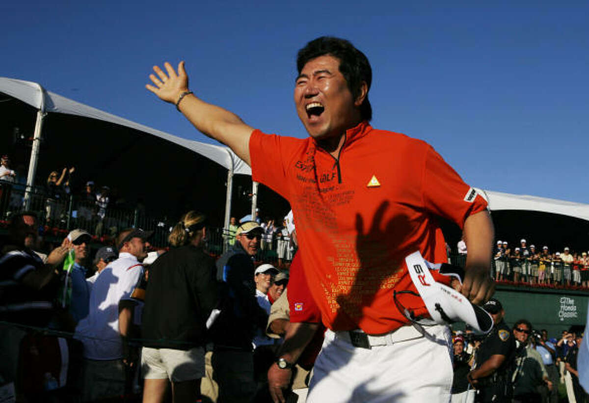 Y.E. Yang celebrates after winning the Honda Classic tournament. Yang shot a final round of 2-under 68 to win with a score of score of 9-under par.