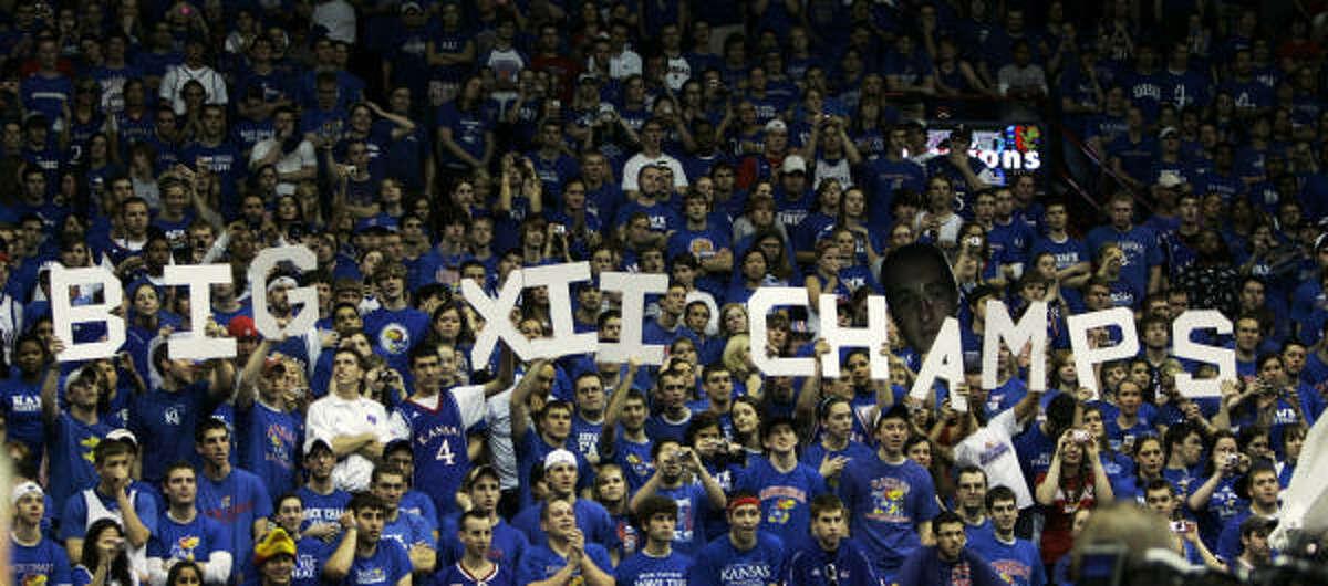 Kansas fans celebrate No. 9 Kansas' 83-73 win over Texas to claim the Big 12 regular season championship.