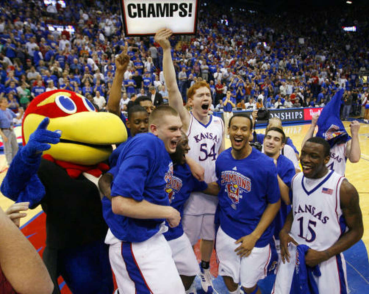 The Kansas Jayhawks reacts after defeating the Texas Longhorns 83-73.