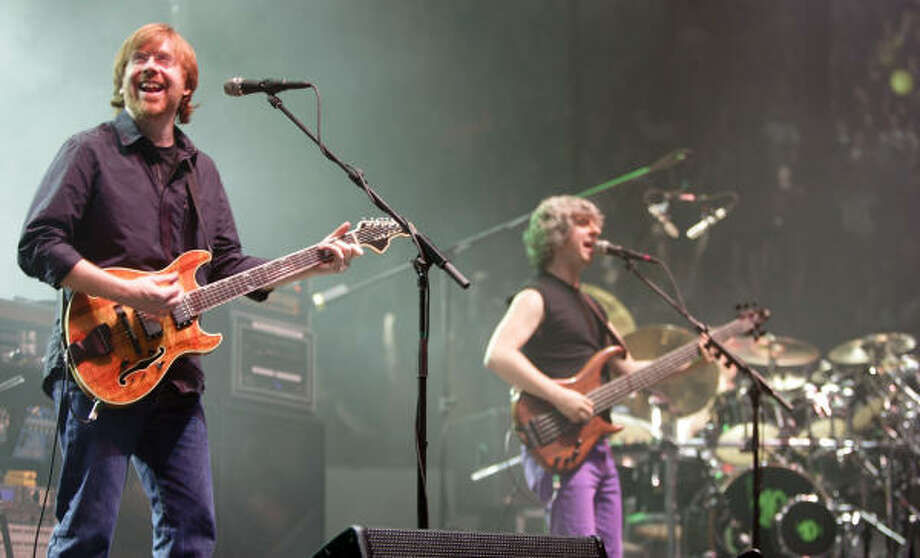Phish guitarist Trey Anastasio, left bassist Mike Gordon, center; and drummer Jon Fishman perform in the opener of a three-night set in Hampton, Va. Photo: Steve Helber, AP