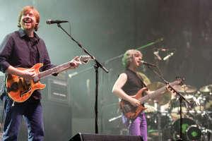 Phish guitarist Trey Anastasio, left bassist Mike Gordon, center; and drummer Jon Fishman perform in the opener of a three-night set in Hampton, Va.