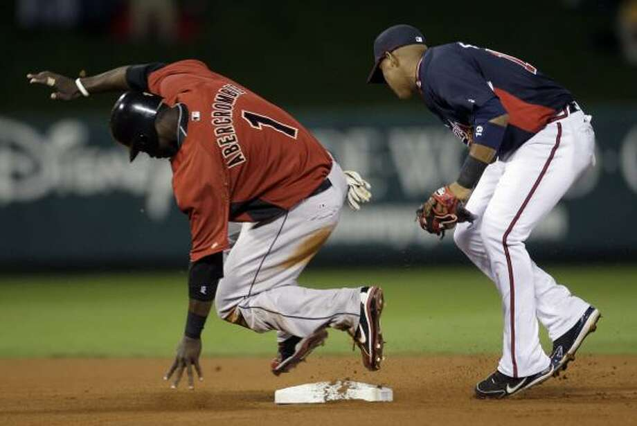 Astros outfielder Reggie Abercrombie (1) safely steals second base while Atlanta Braves infielder Yunel Escobar, right, looks for the ball during the first inning. Photo: Rob Carr, AP