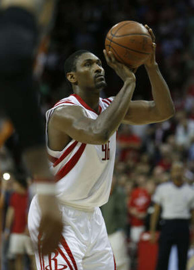 Ron Artest sinks his second of two free throws to seal the game and give the Rockets a four-point lead with seven seconds left. Photo: Julio Cortez, Chronicle