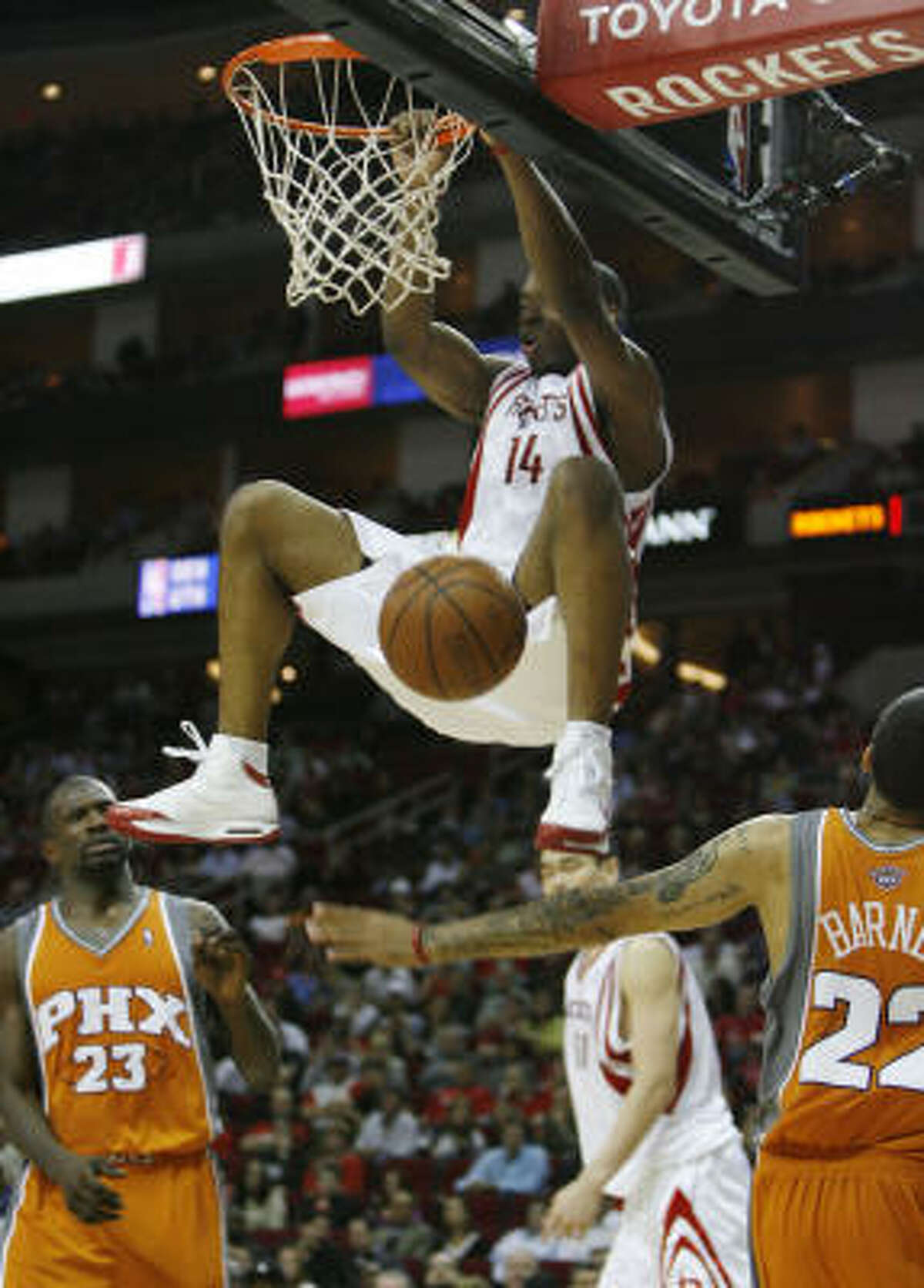 Carl Landry dunks in the fourth quarter against the Suns.