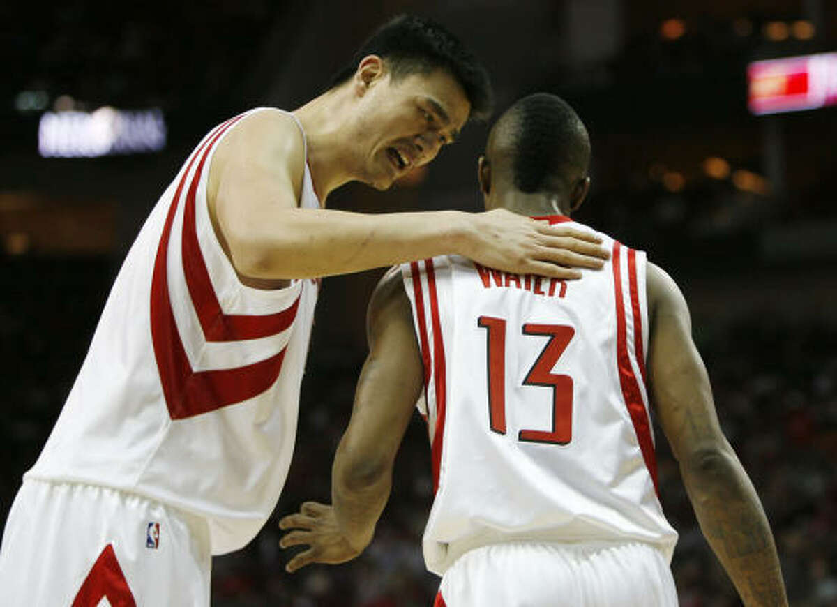 Rockets center Yao Ming, left, talks with teammate Von Wafer in the fourth quarter.