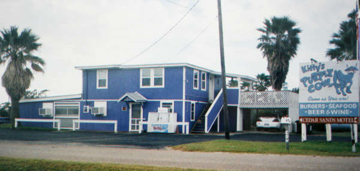 Kitty's Purple Cow, in Surfside, the day before Hurricane Ike. The bright purple burger, seafood and chicken-fried steak emporium on the Bluewater Highway has been a Surfside landmark since Smith and her late husband, Mike, opened it in 1983.