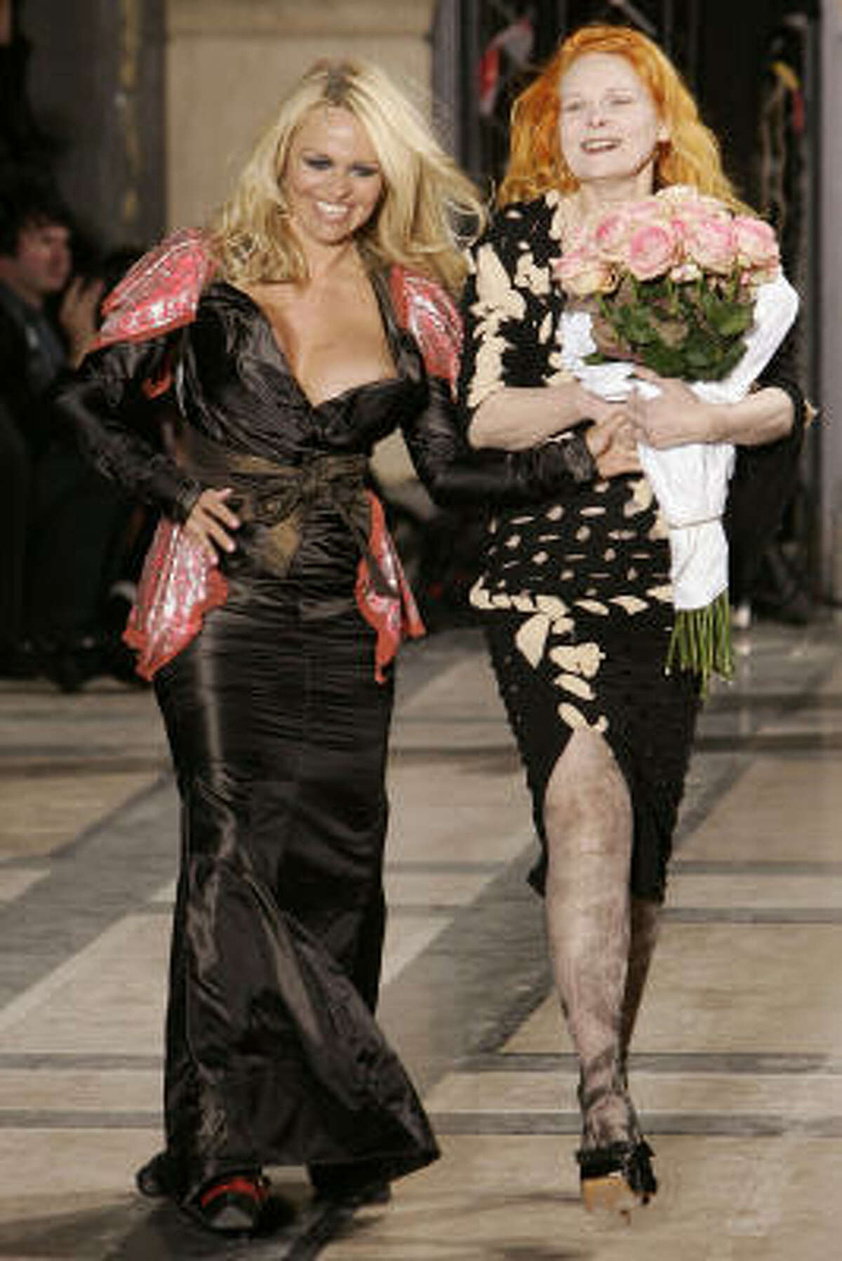 Anderson, left, and Westwood appear on the runway following the presentation of Westwood's collection.