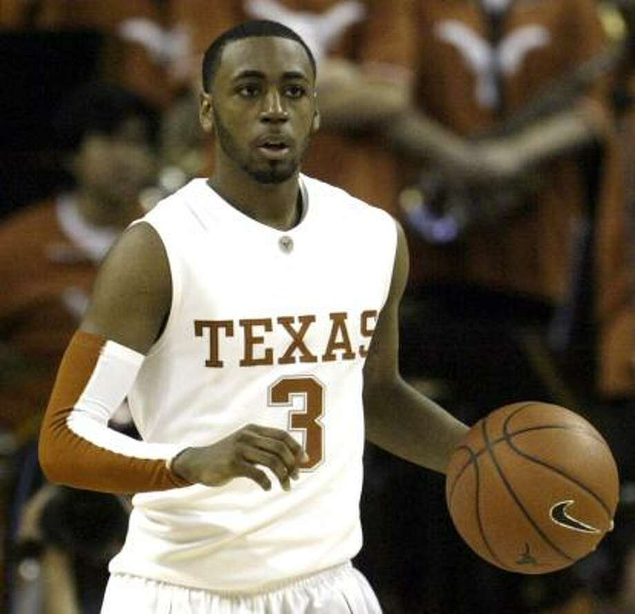 Texas guard A.J. Abrams brings the ball down court during the second half of an NCAA men's college baskebtall game against Stetson, Friday, Nov. 14, 2008, in Austin, Texas. Abrams was the high scorer with 21 total points in Texas' 68-38 victory over Stetson. Photo: Harry Cabluck, AP