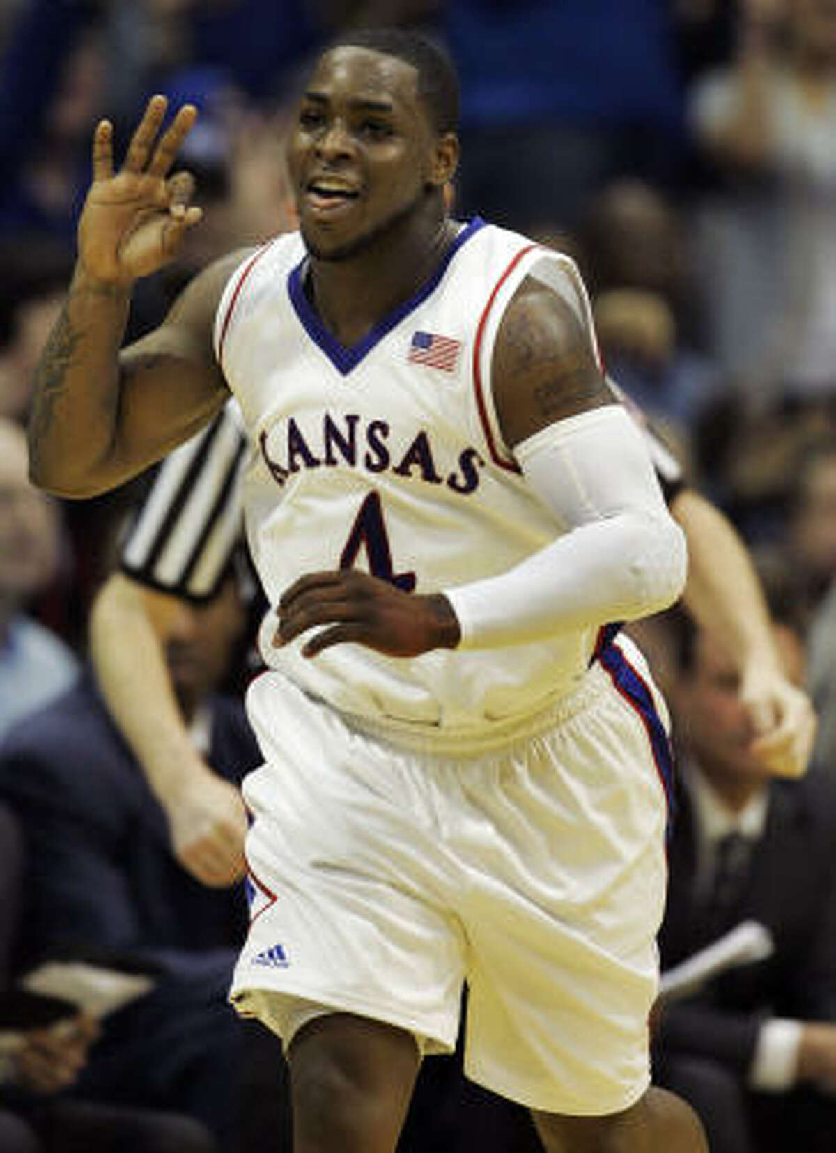 Kansas guard Sherron Collins (4) celebrates a 3 point basket during the second half of an NCAA college basketball game against Missouri in Lawrence, Kan., Sunday, March 1, 2009. Collins scored 25 points to lead Kansas to a 90-65 win over Missouri.