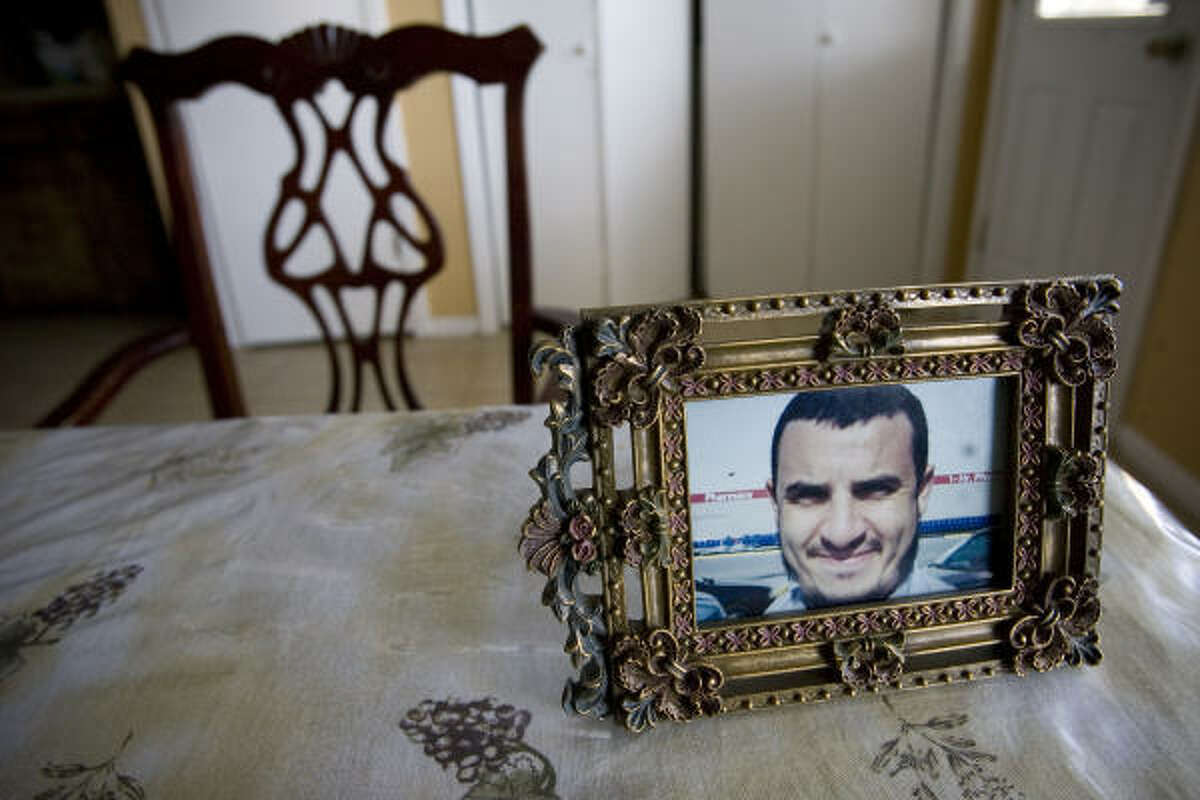 An empty chair sits at the head of the family's dining table with a photograph of Sheikh Zoubir Bouchikhi, who is facing deportation. Bouchikhi has lived in the U.S. for 11 years and has three American-born children. The popular imam's detention has angered Houston-area Muslims, who are rallying to support Bouchikhi with letter-writing campaigns, petitions and Web sites.