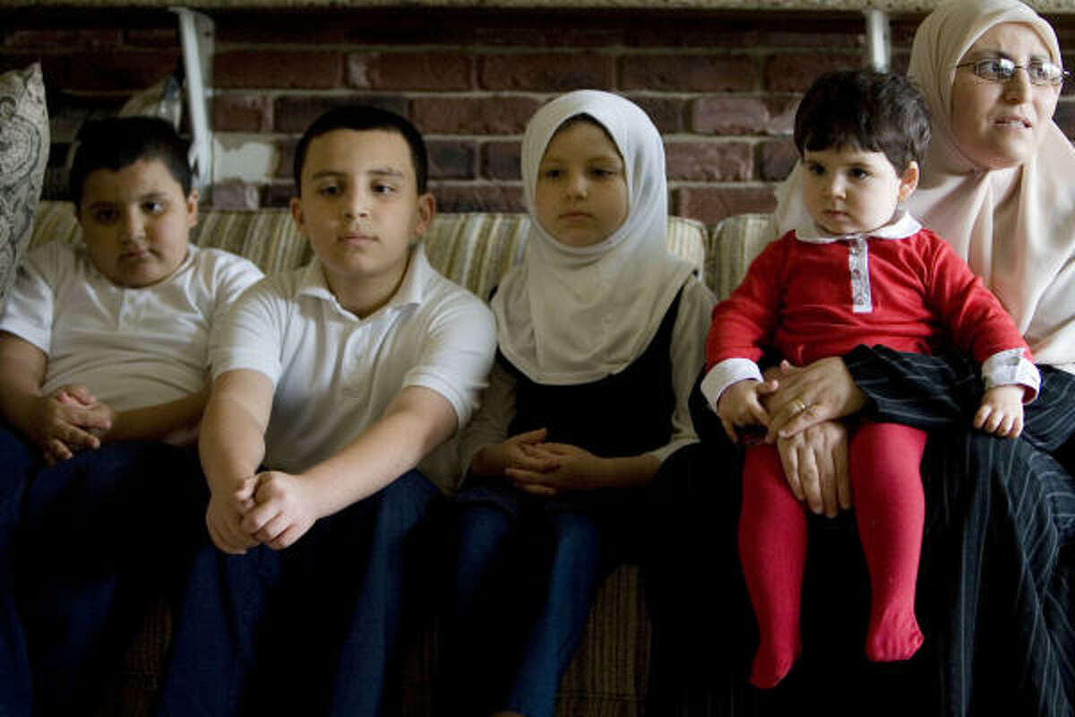 Mounira Belhacel-Bouchikhi and her children, from left, El-Faroq Bouchikhi, 9, Ilies, 12, Bushra, 7 and Shareefah, 18 months, anxiously wait for word about father and husband Sheikh Zoubir Bouchikhi. His attorney, Brian Bates, believes the imam is caught up in a backlash over recently tightened visa regulations for religious workers.