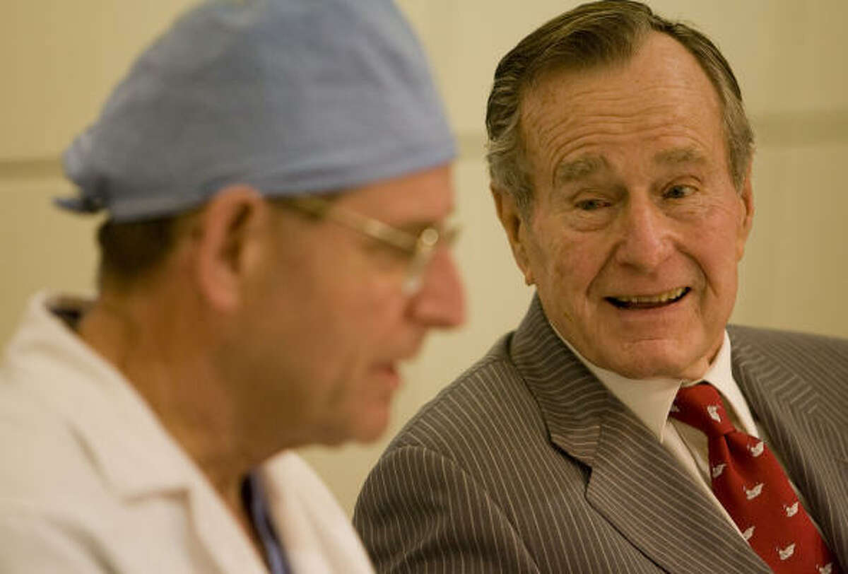 Former President George H. W. Bush tears up as he speaks with Dr. Gerald Lawrie during a news conference at The Methodist Hospital after Dr. Lawrie performed heart surgery on Barbara Bush.