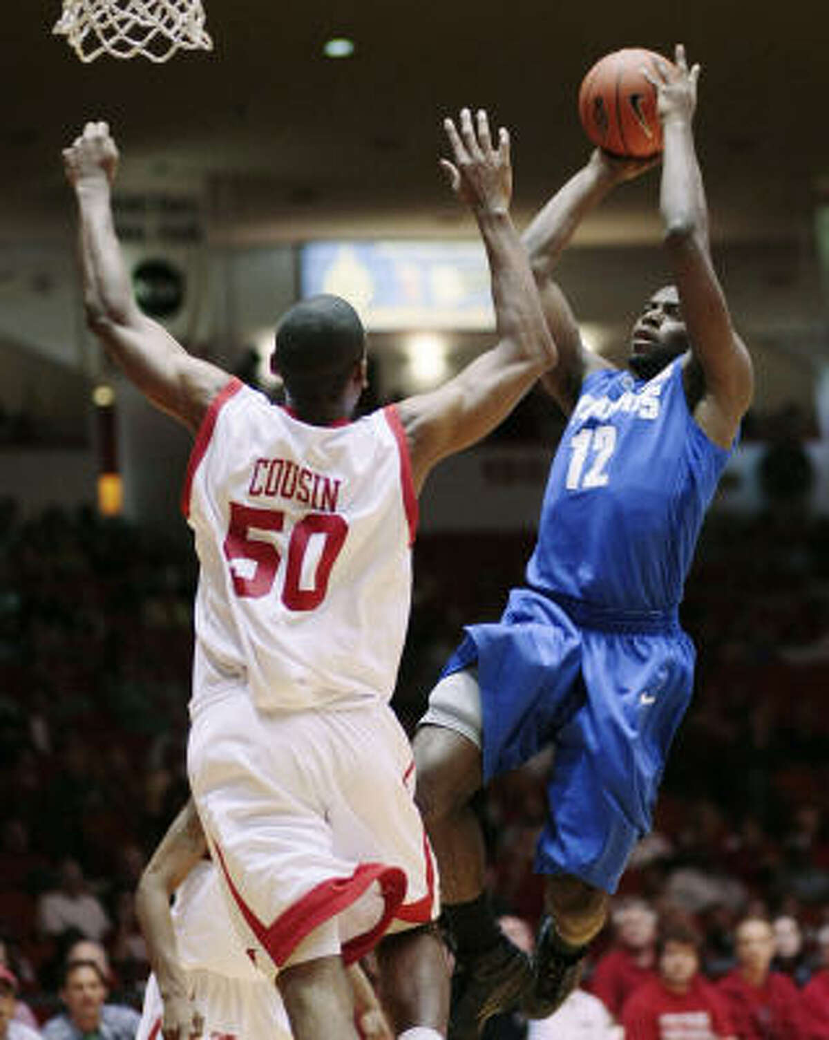 Memphis' Tyreke Evans shoots over Houston's Marcus Cousin.