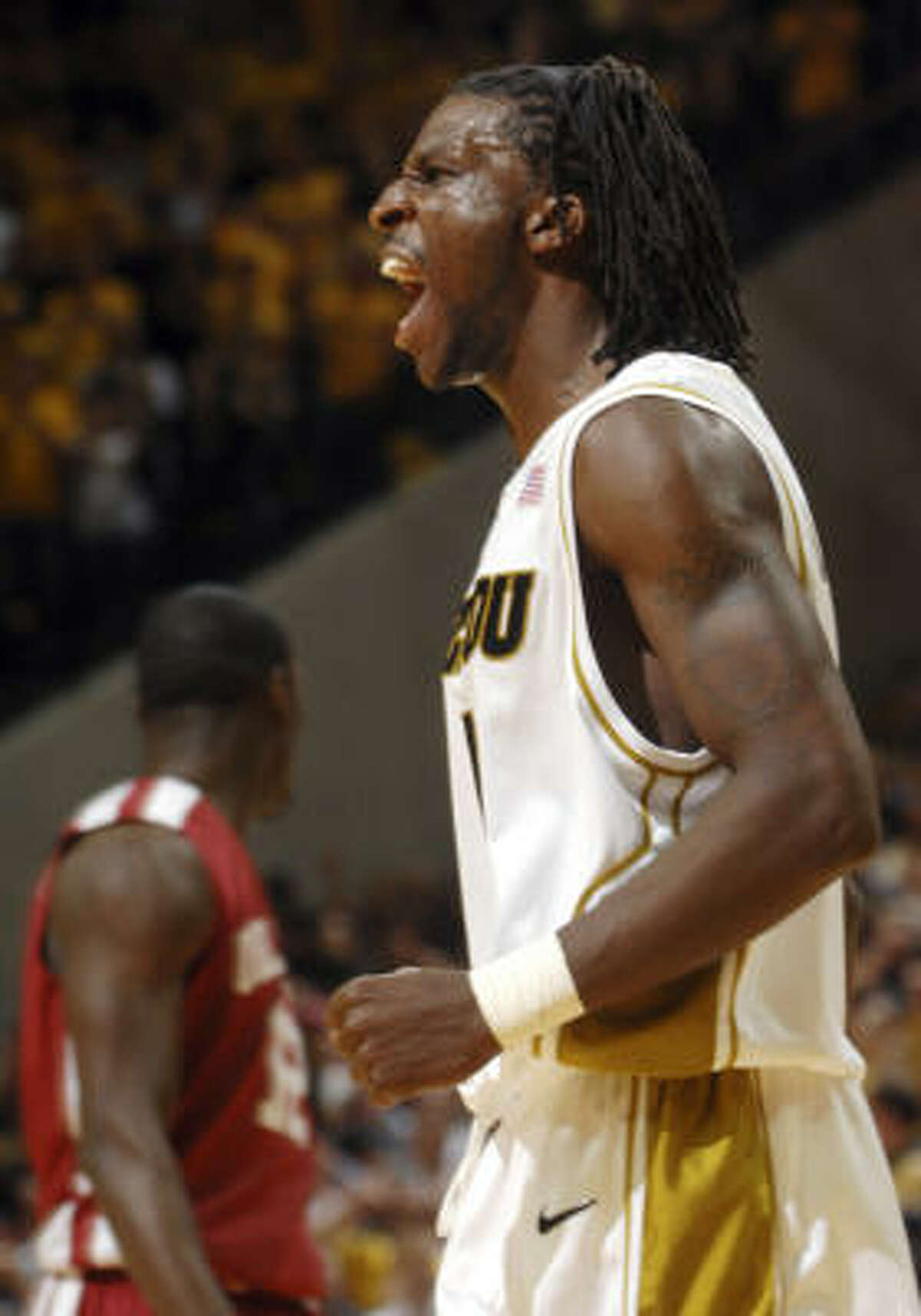Missouri's DeMarre Carroll reacts after making a basket while getting fouled. Missouri won the game 73-64.
