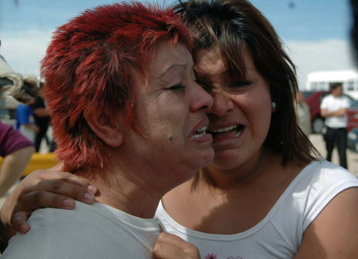 Relatives of prison inmates react as they wait for news outside a state prison during a riot in Ciudad Juarez, Mexico, Wednesday. The fight broke out shortly after 6 a.m. as visitors were leaving after an evening of conjugal visits.
