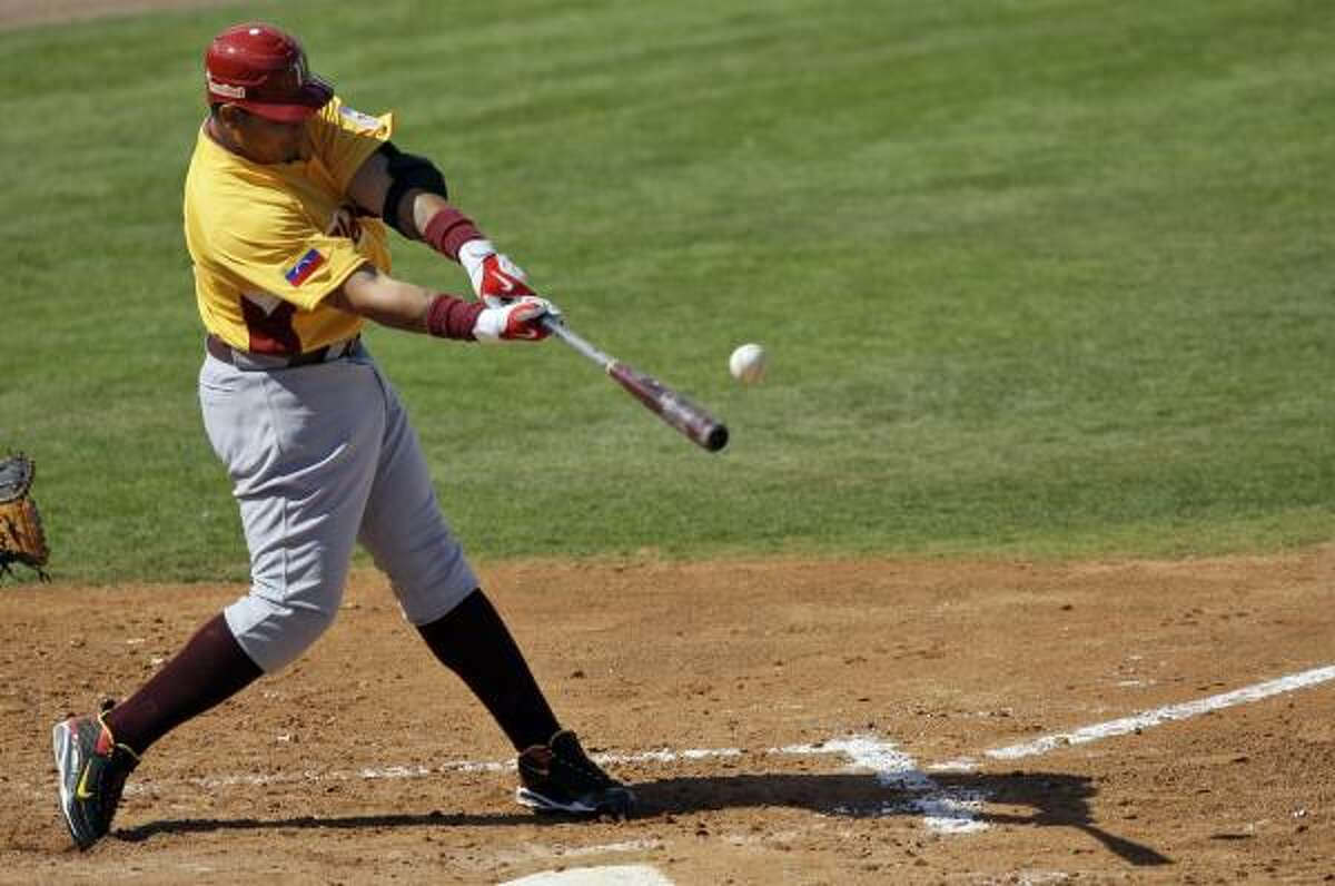 Venezuela's Miguel Cabrera hits a two-run single against the Astros during an exhibition spring training game, Wednesday, March 4, 2009, in Kissimmee, Fla.