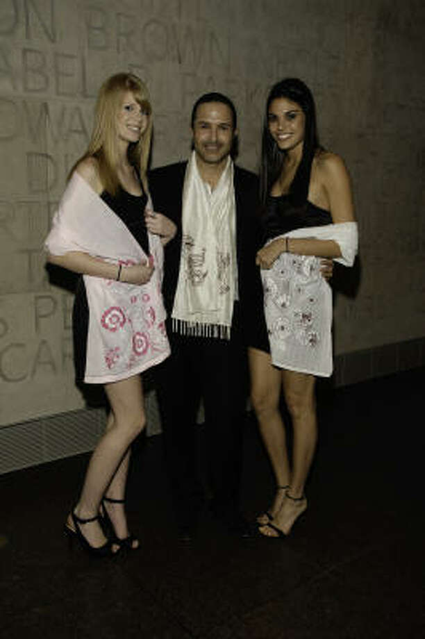Matin poses with models wearing Afghan Hands scarves at the Museum of Fine Arts Houston. Photo: Fulton Davenport