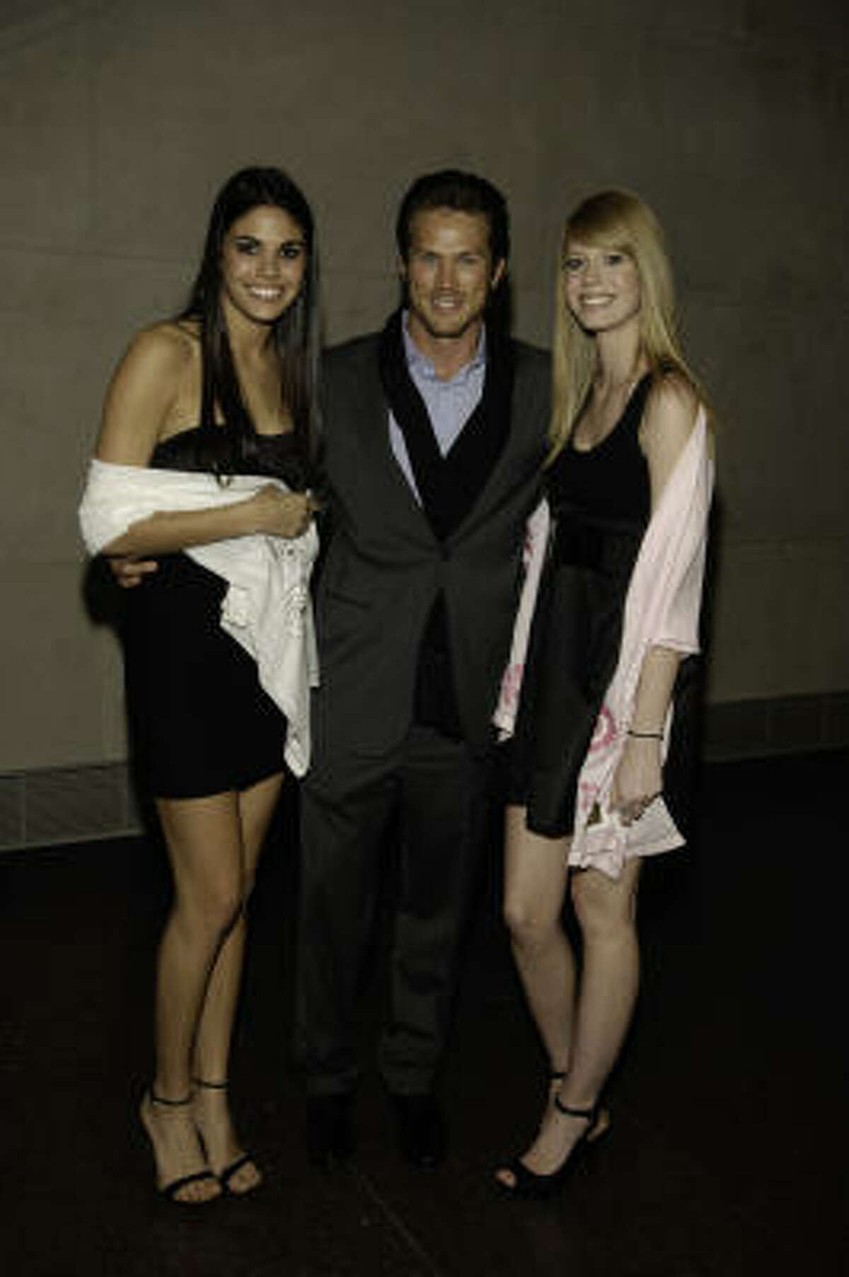"""Matin's friend, actor Jason Lewis (Samantha's boyfriend in """"Sex and the City"""") poses with models wearing Afghan Hands scarves at the Museum of Fine Arts Houston."""