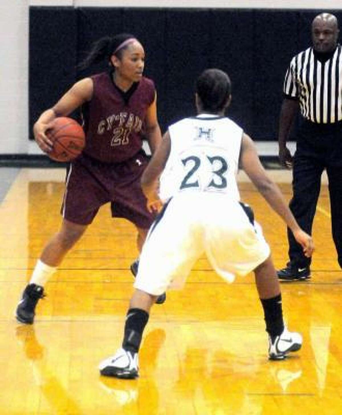 Cy-Fair point guard Cassie Peoples brings the ball upcourt against Hightower defender Bria Butler during the game on Nov. 14 in Missouri City.
