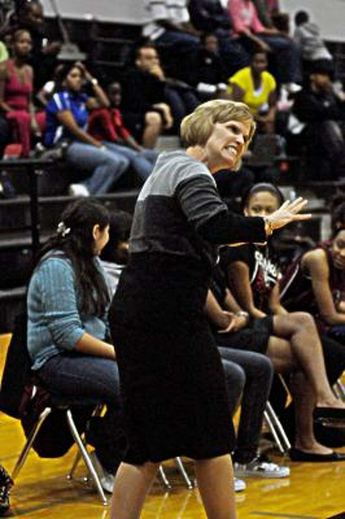 Cy-Fair head coach Ann Roubique reacts during a game against Hightower. The Lady Bobcats lost to on a last minute shot at the buzzer.