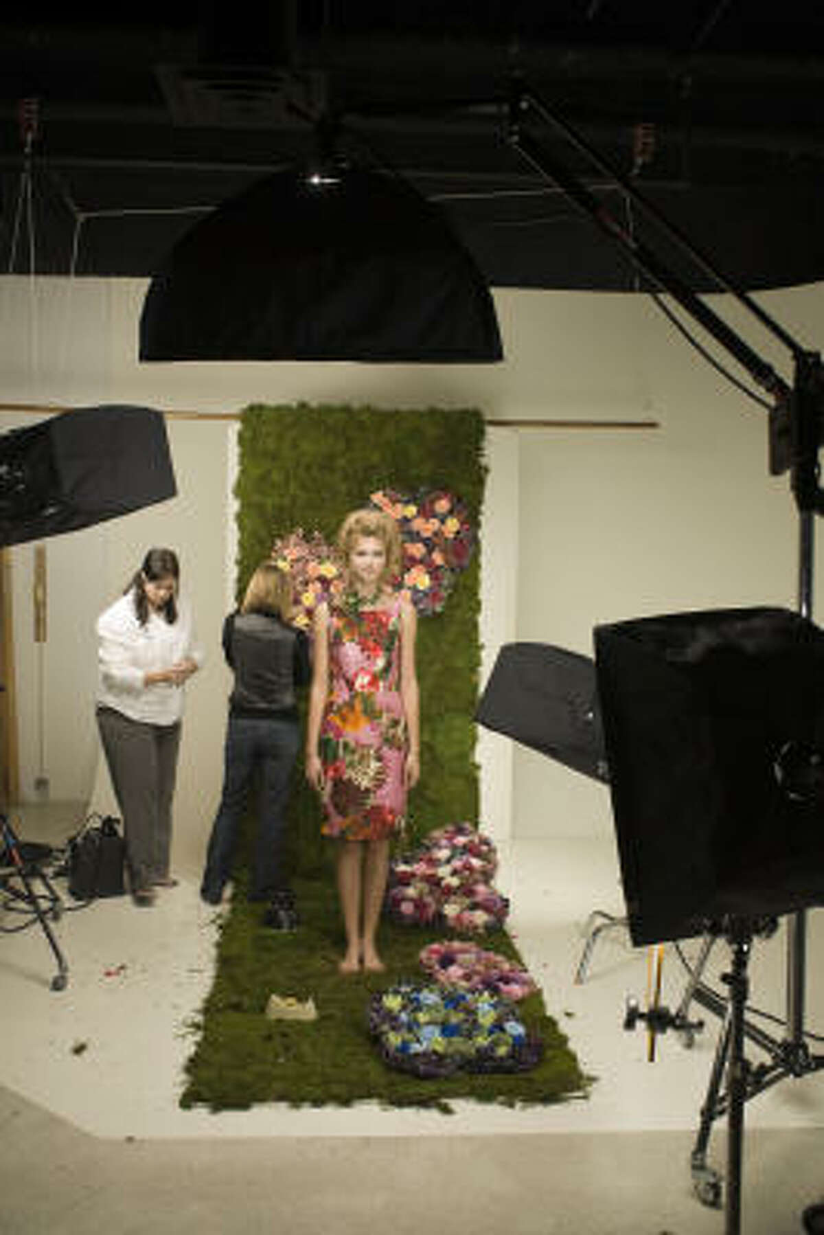 Allyson Cook of Page Parkes Models gets ready for a photo shoot in an Oscar de la Renta sleeveless floral sheath.