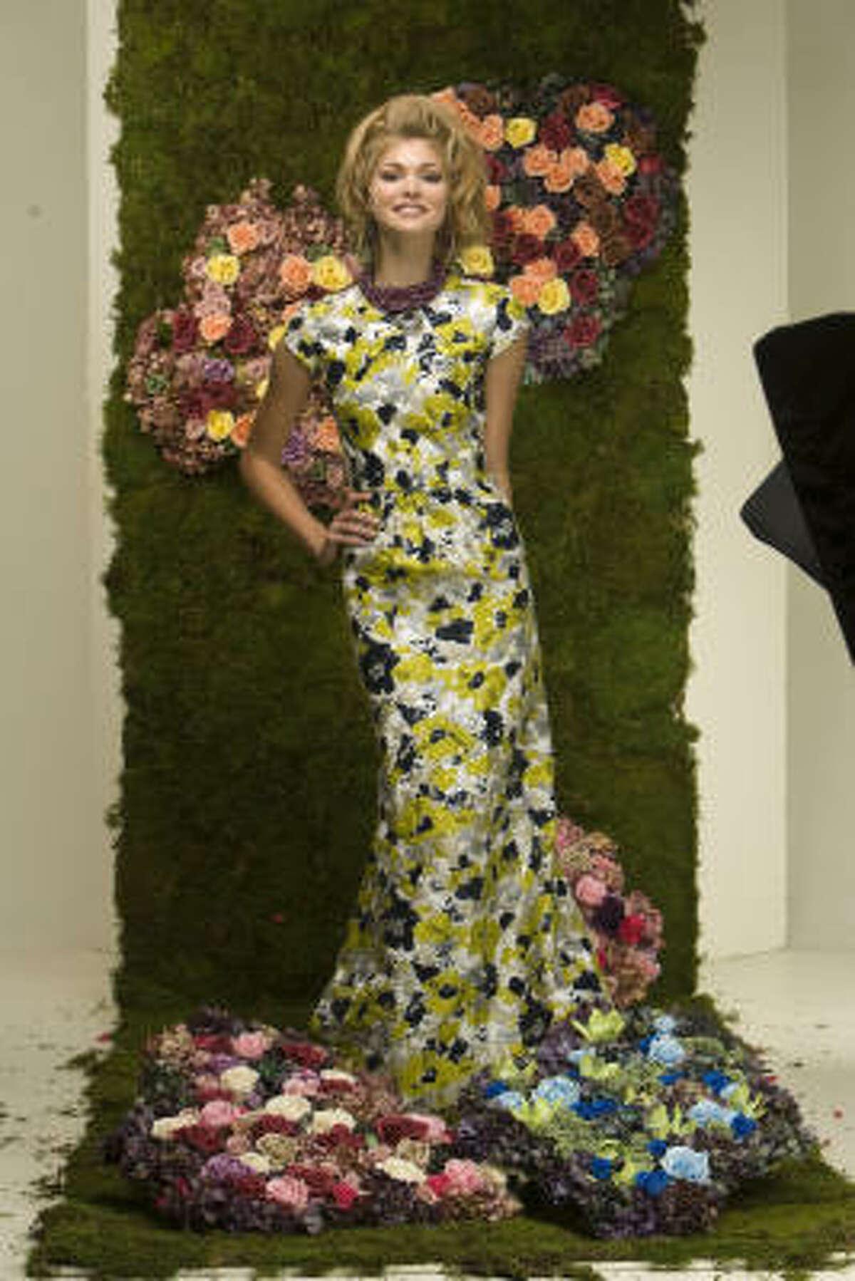 Allyson Cook of Page Parkes Models blossoms in an Oscar de la Renta avocado green floral cap sleeve gown.