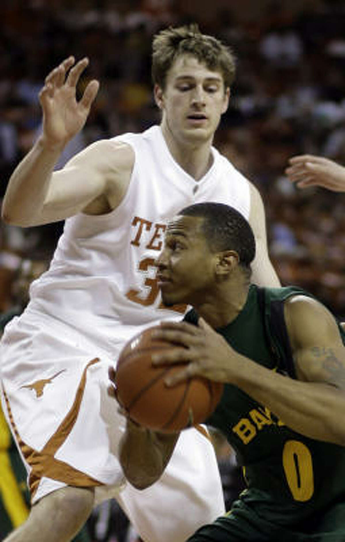 Baylor guard Curtis Jerrells, right, tries to get around Texas center Connor Atchley during the first half of Monday's game in Austin. Jerrells scored 14 points, but it wasn't enough to keep Baylor from dropping a 73-57 decision.