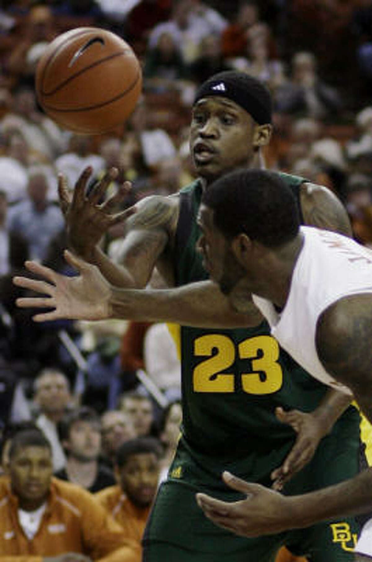 Baylor forward Kevin Rogers, left, reaches for a loose ball in front of Texas forward Damion James during the first half.
