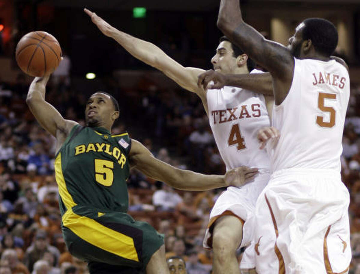 Baylor guard Henry Dugat, left, goes up to shoot against Texas guards Dogus Balbay, center, and Damion James during the first half.