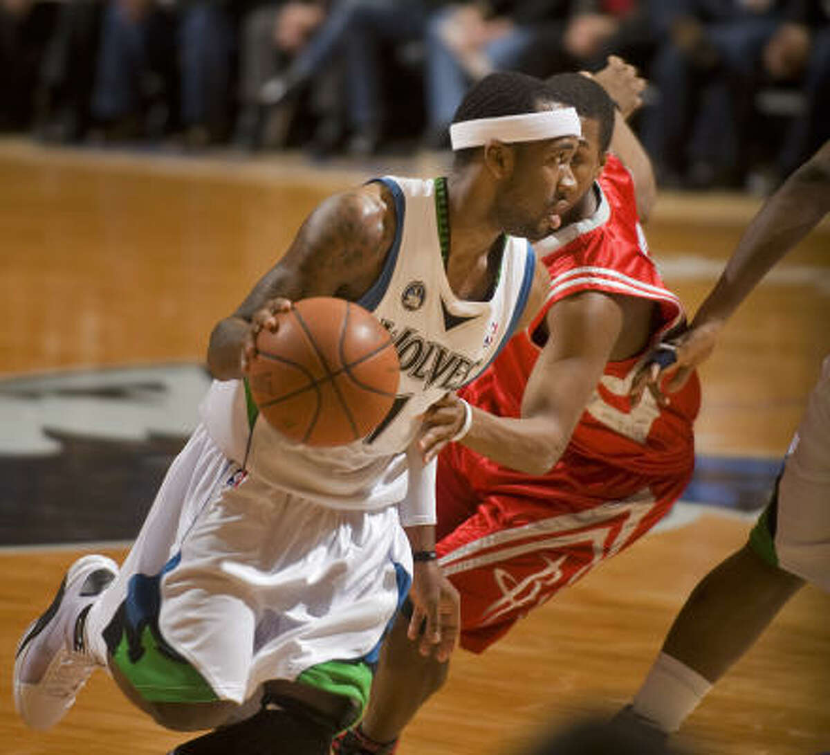 Timberwolves guard Bobby Brown drives past Kyle Lowry on his way to the basket in the third quarter.