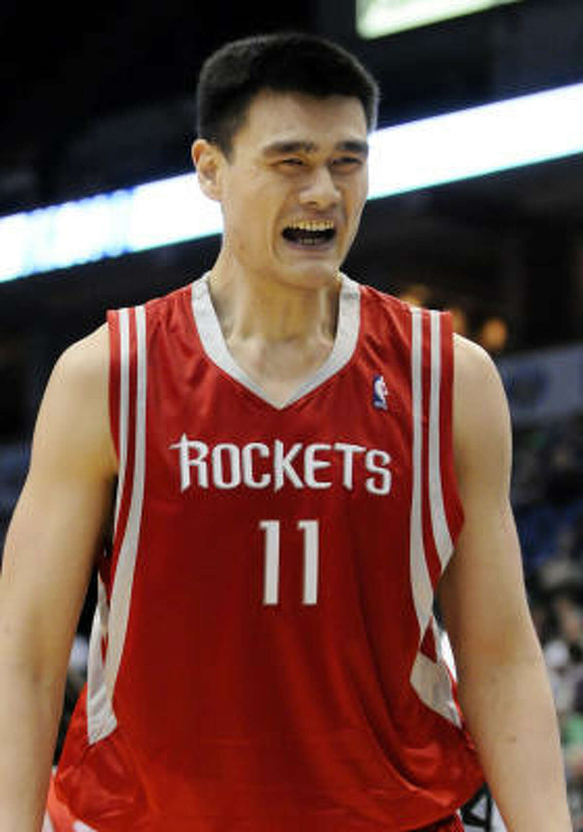 Rockets center Yao Ming protests a traveling call in the third quarter.