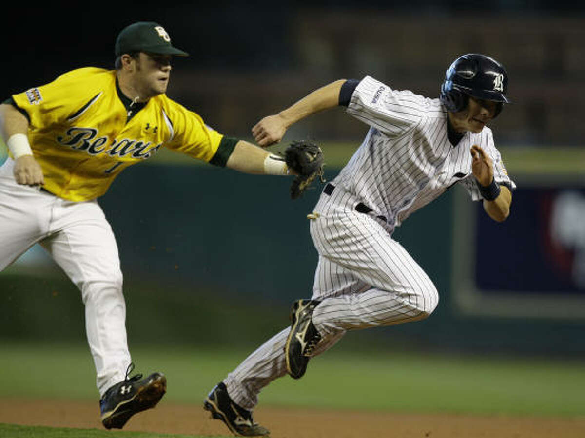 Baylor's Joey Hainsfurther catches Rice's Brock Holt in a rundown between first and second base.