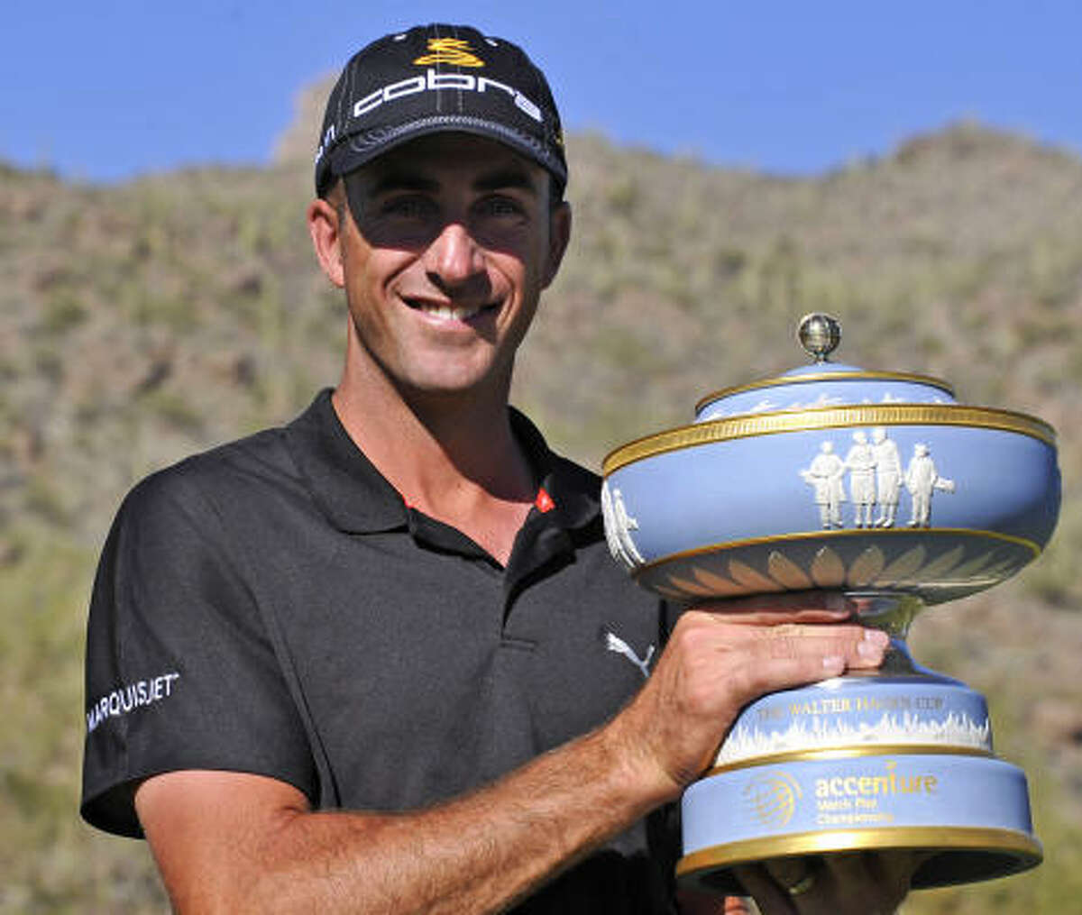 Geoff Ogilvy holds the winner's trophy after his 4 and 3 victory over Paul Casey in the finals of the World Golf Championships Accenture Match Play Championship.