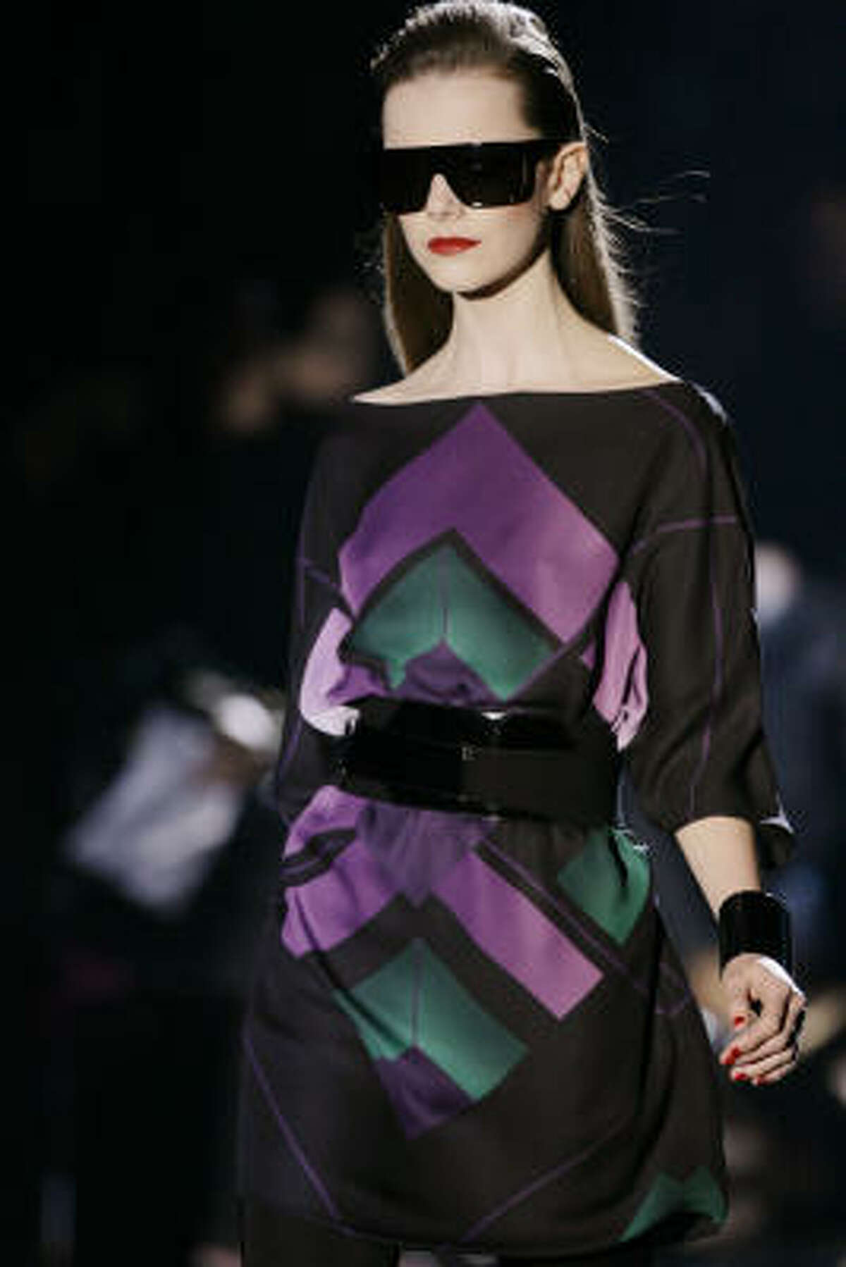 A model shows a creation from the Gucci Fall/Winter 2009/2010 fashion collection shown in Milan, Italy, on Saturday, Feb. 28, 2009.