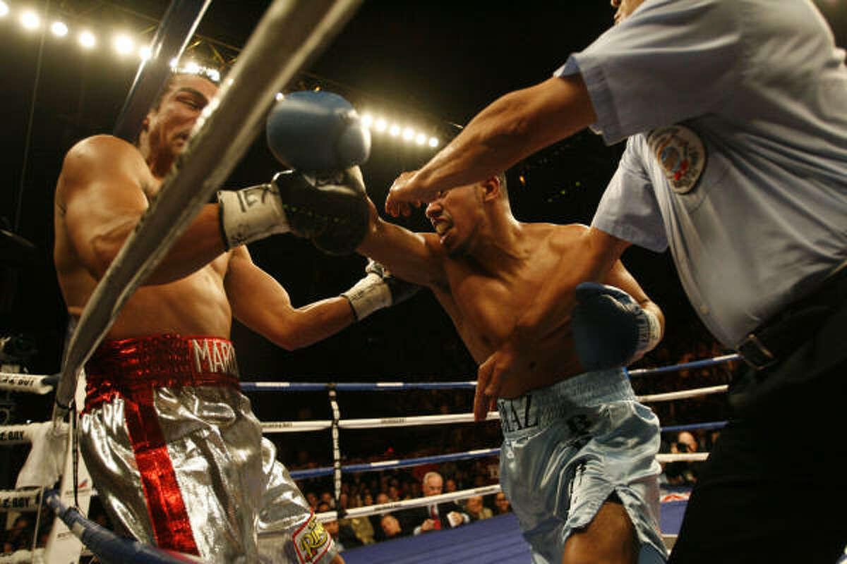 Juan Diaz gets Juan Manuel Marquez against the ropes.