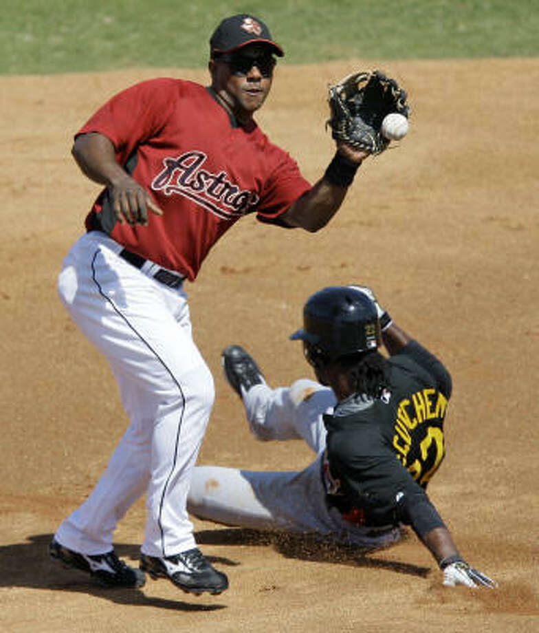 Astros shortstop Miguel Tejada, left, catches the throw from the catcher as Pittsburgh Pirates' Andrew McCutchen, right, steals second base. Photo: David J. Phillip, AP