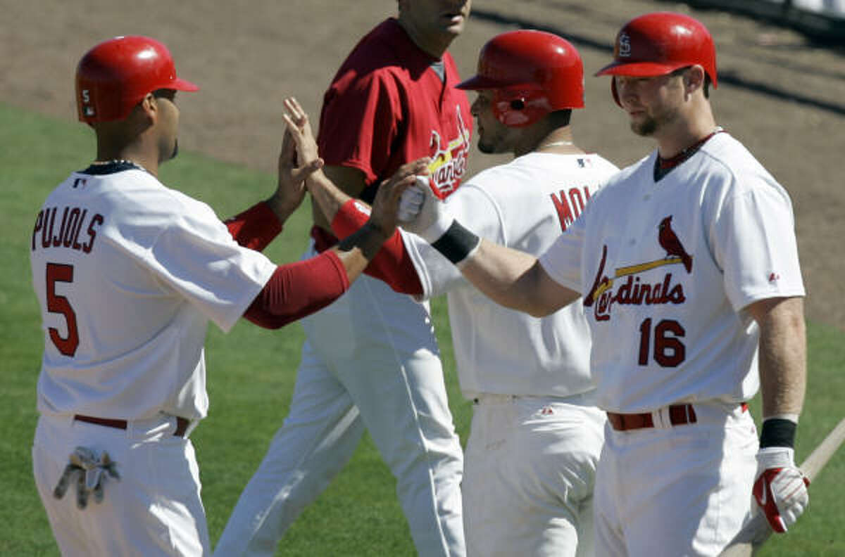 St. Louis Cardinals' Chris Duncan, right, congratulates teammates Yadier Molina, center, and Albert Pujols, left, after they scored on a two-run double by Ryan Ludwick (not shown).