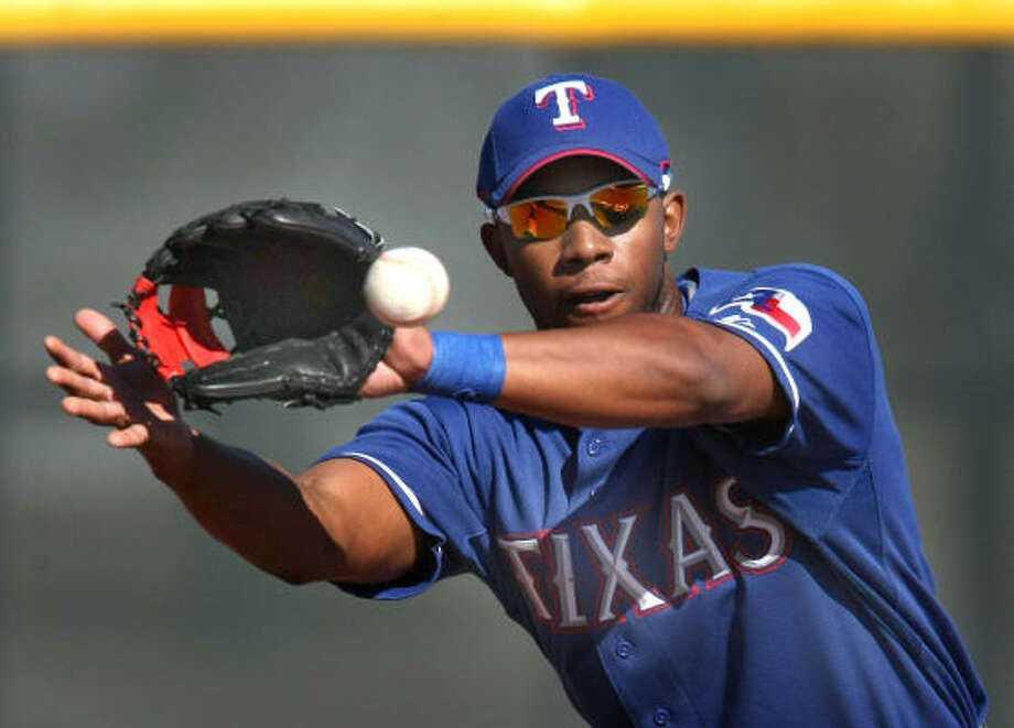 Texas Rangers shortstop Elvis Andrus takes infield practice. Photo: RON JENKINS, MCT