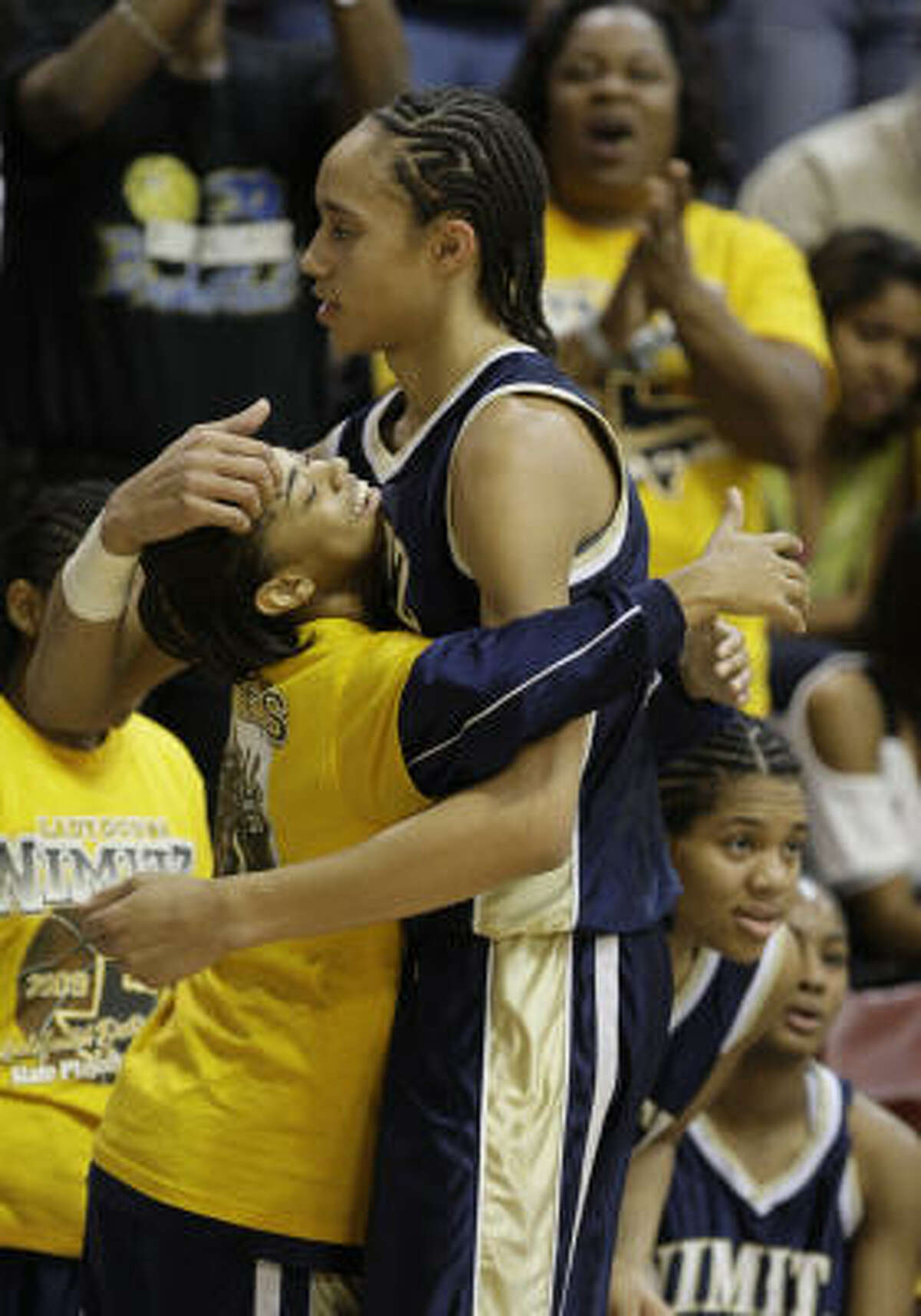 SaKatherine Johnson, left, and Brittney Griner celebrate the 45-26 victory over Bellaire in the final seconds.