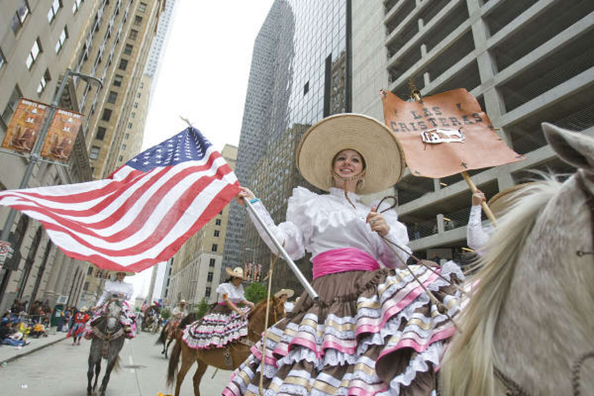 Lissette Lozano of Las Cristeras riding team rides in the Charraria portion of the Houston Livestock Show and Rodeo parade.