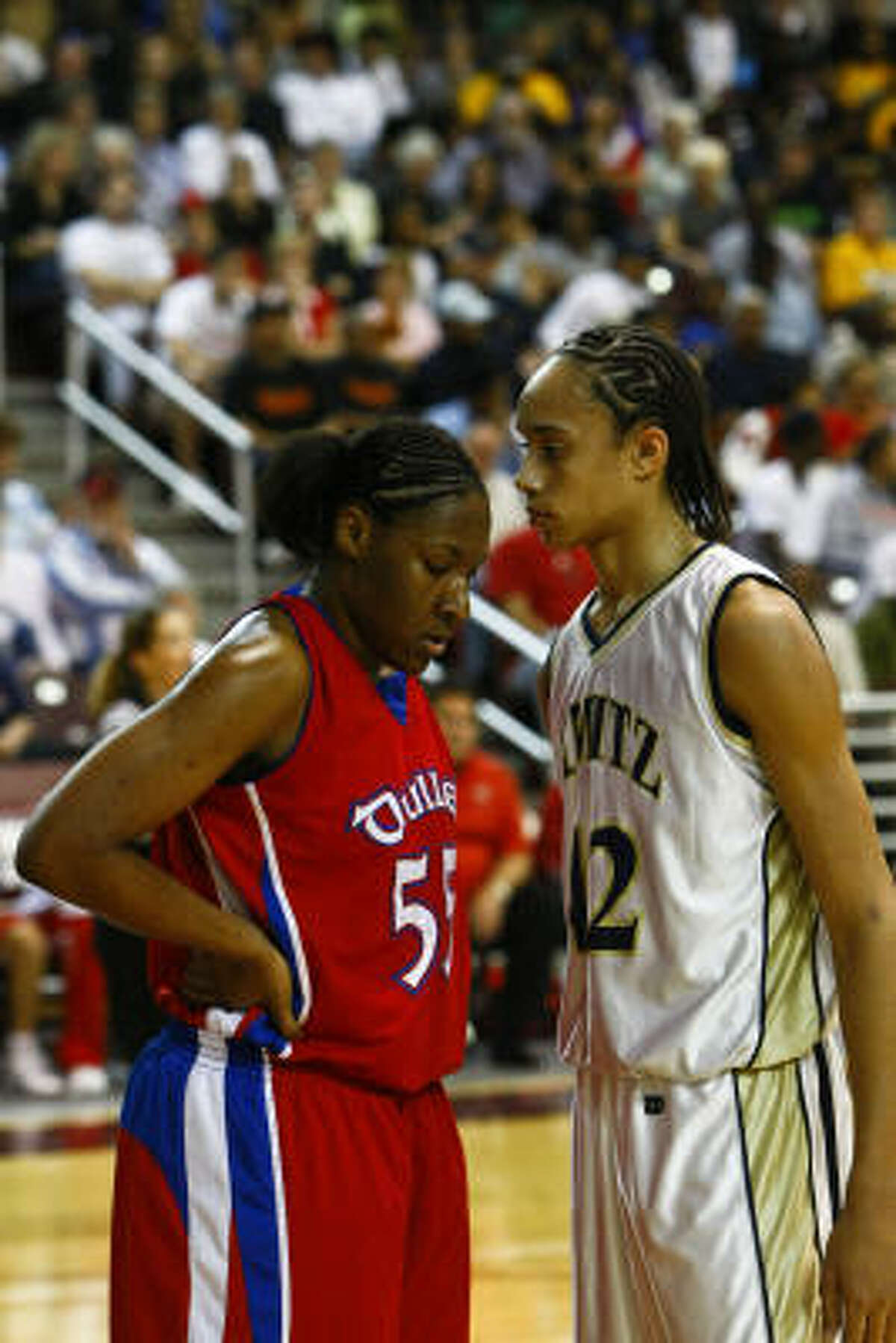 Brittney Griner (42) of Nimitz looks at Kelsey Bone (55) of Dulles at the beginning of Nimitz's 76-59